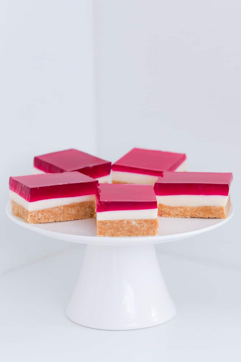 Triple layer jelly slice with biscuits, condensed milk and raspberry jelly.