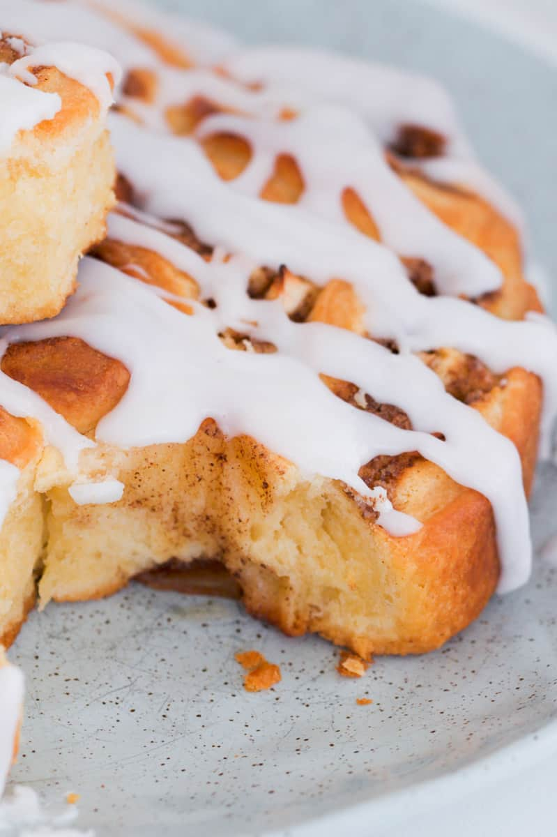 A apple and cinnamon scroll with sweet white glaze.