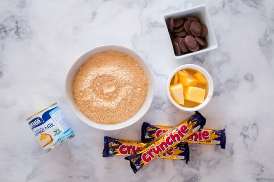 The ingredients for chocolate honeycomb slice using Cadbury Crunchie bars.