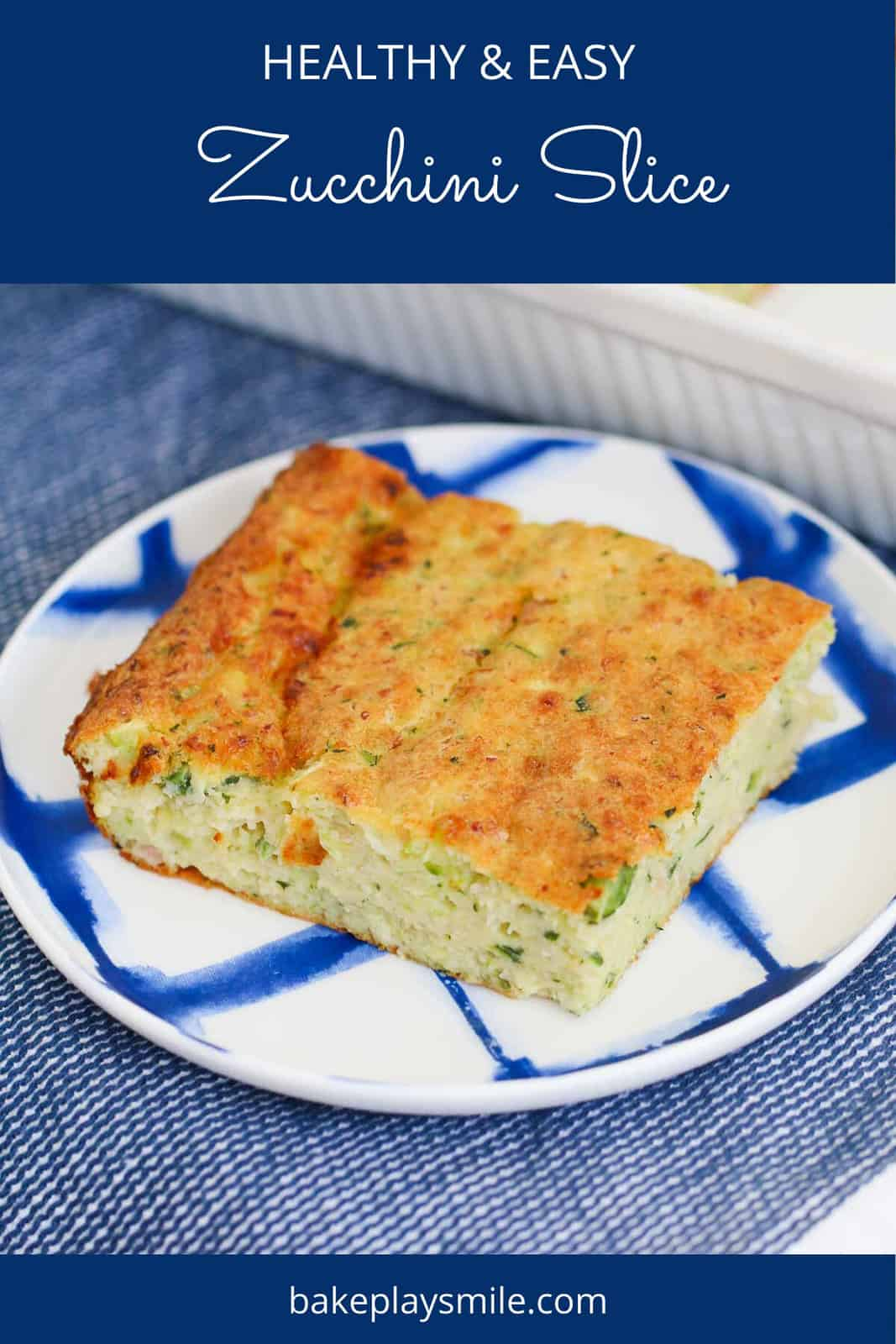 A piece of homemade zucchini slice on a blue and white plate.