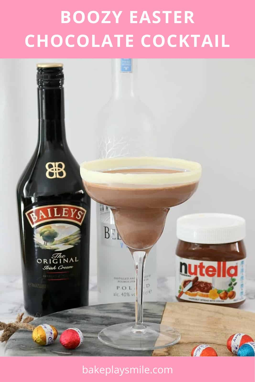 A chocolate cocktail in a glass with nutella, baileys, vodka and easter eggs around it.