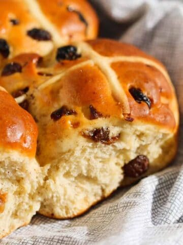 Our traditional homemade hot cross buns are soft, fluffy and simple to make... plus they taste even better than the store-bought version!