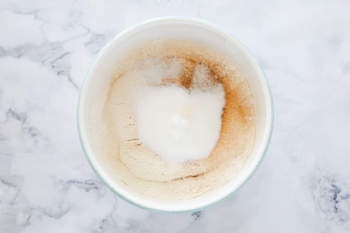 Sugar, flour and cinnamon in a bowl.