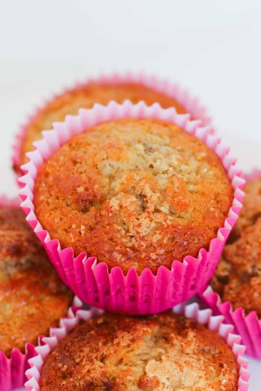 A stack of Muffins in pink muffin cases
