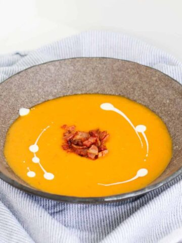 A rich and creamy classic roast pumpkin soup recipe that's so simple to make... try it served with crispy bacon, a swirl of cream and lots of crusty buttered bread for the ultimate comfort food meal.