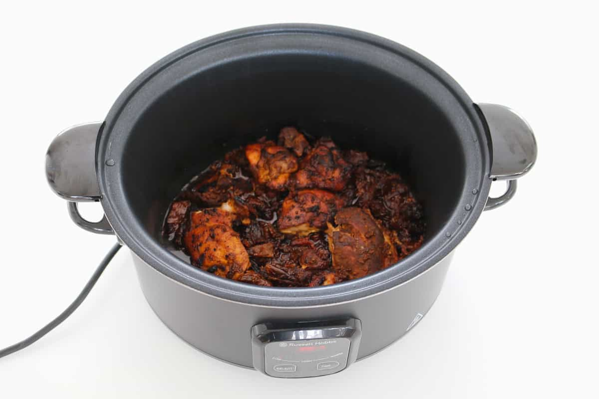 Seared paprika chicken in a slow cooker.