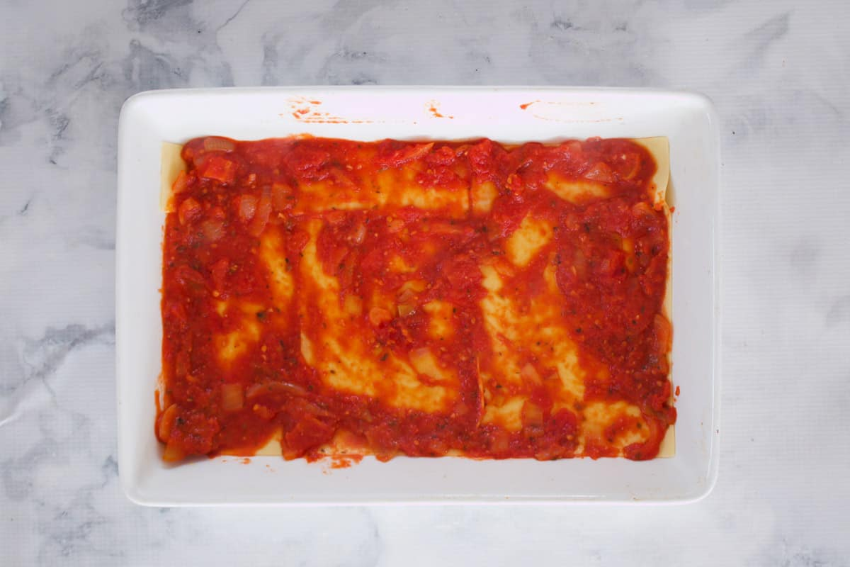 Tomato sauce in a white baking dish.