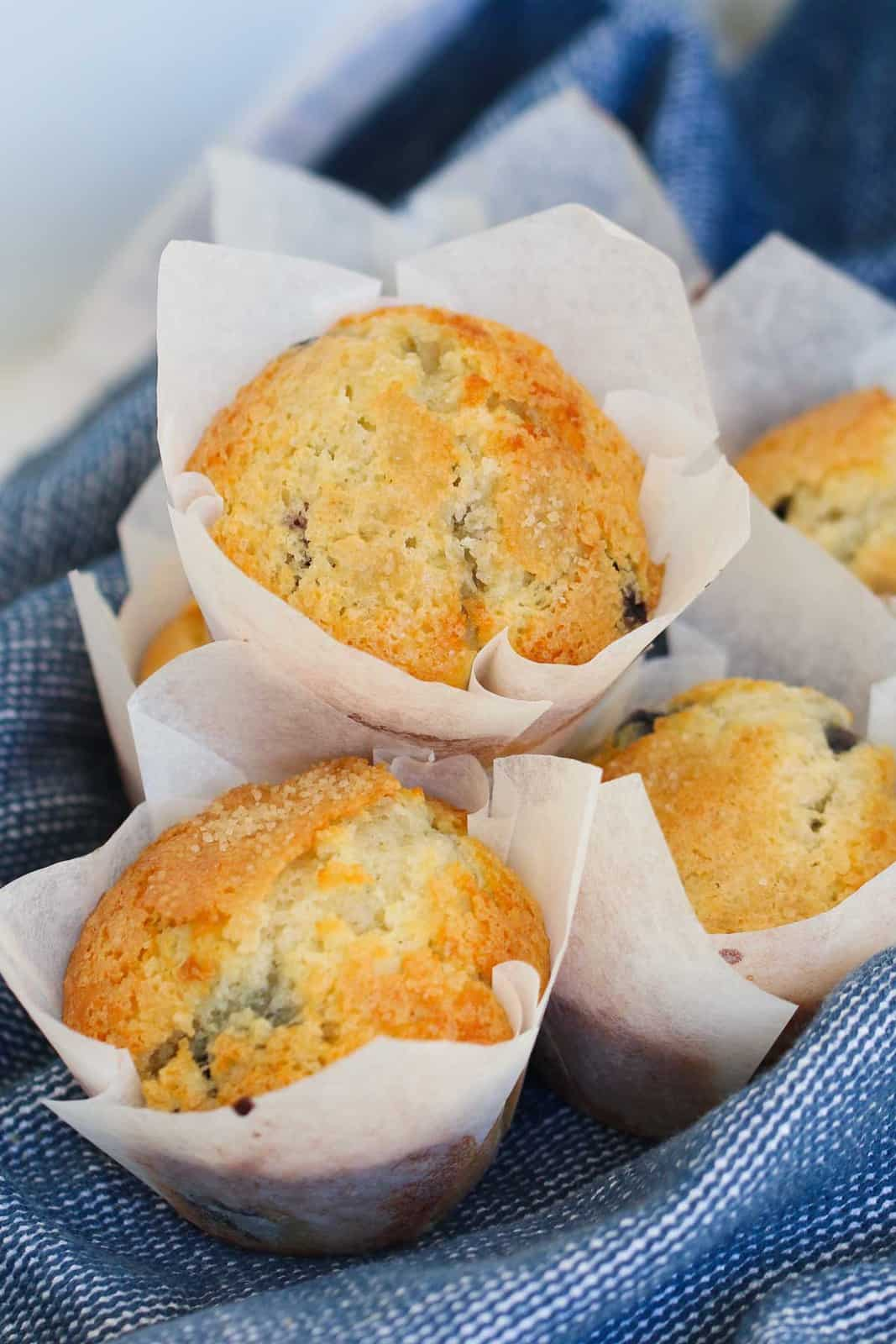 A stack of fruit muffins with sugar topping.