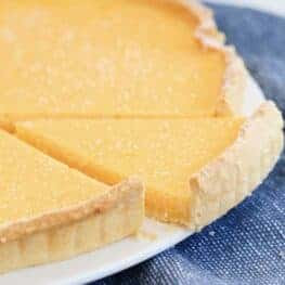 A slice of creamy lemon filling in a pie.