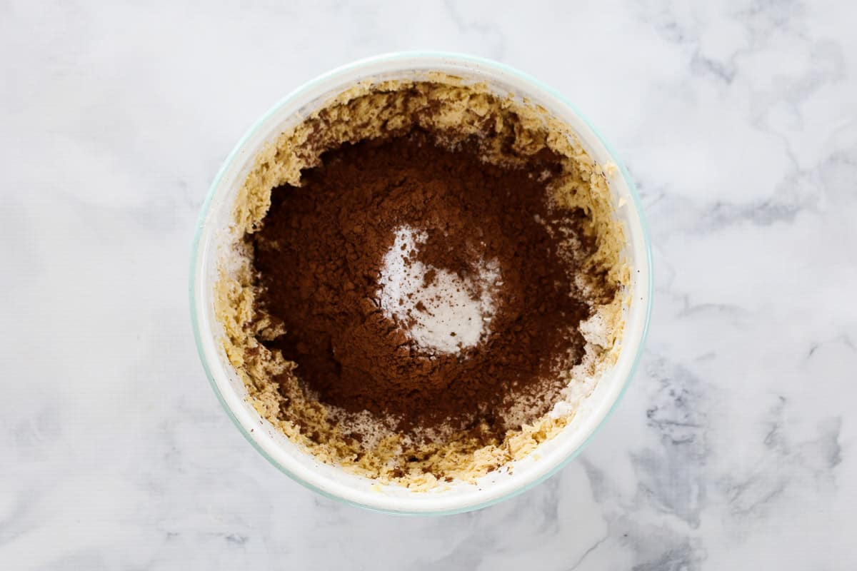 Cocoa, caster sugar and bi-carbonate soda in a bowl with creamed butter and sugar.