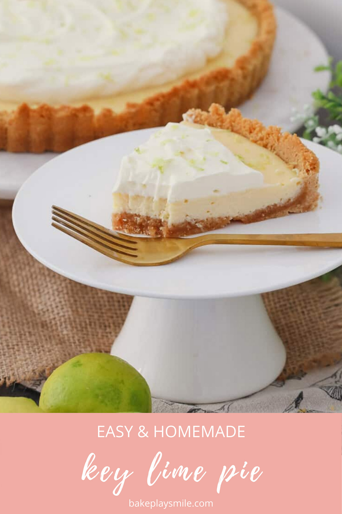 A half-eaten piece of lime tart on a white cake stand with a gold fork.