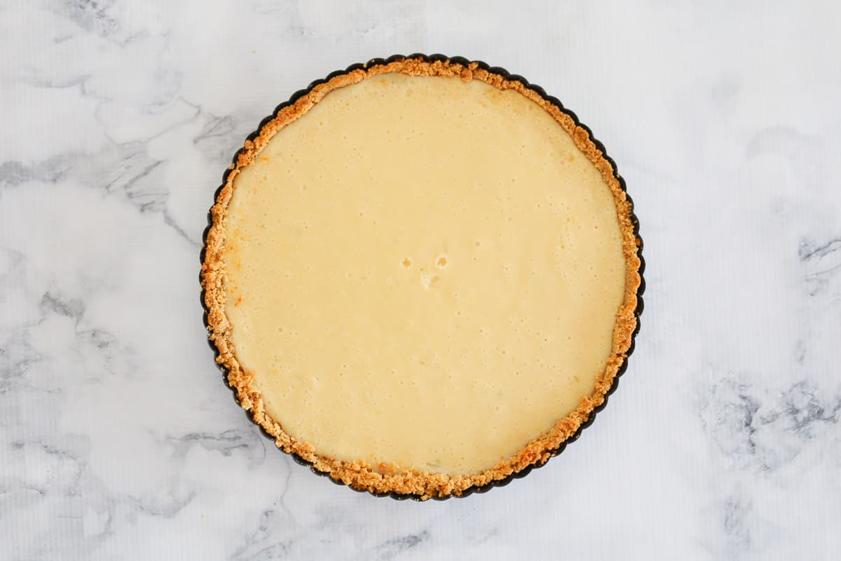 A creamy filling on a biscuit base in a round pie tin.
