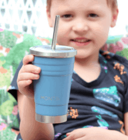 A child holding a blue drinking cup with straw
