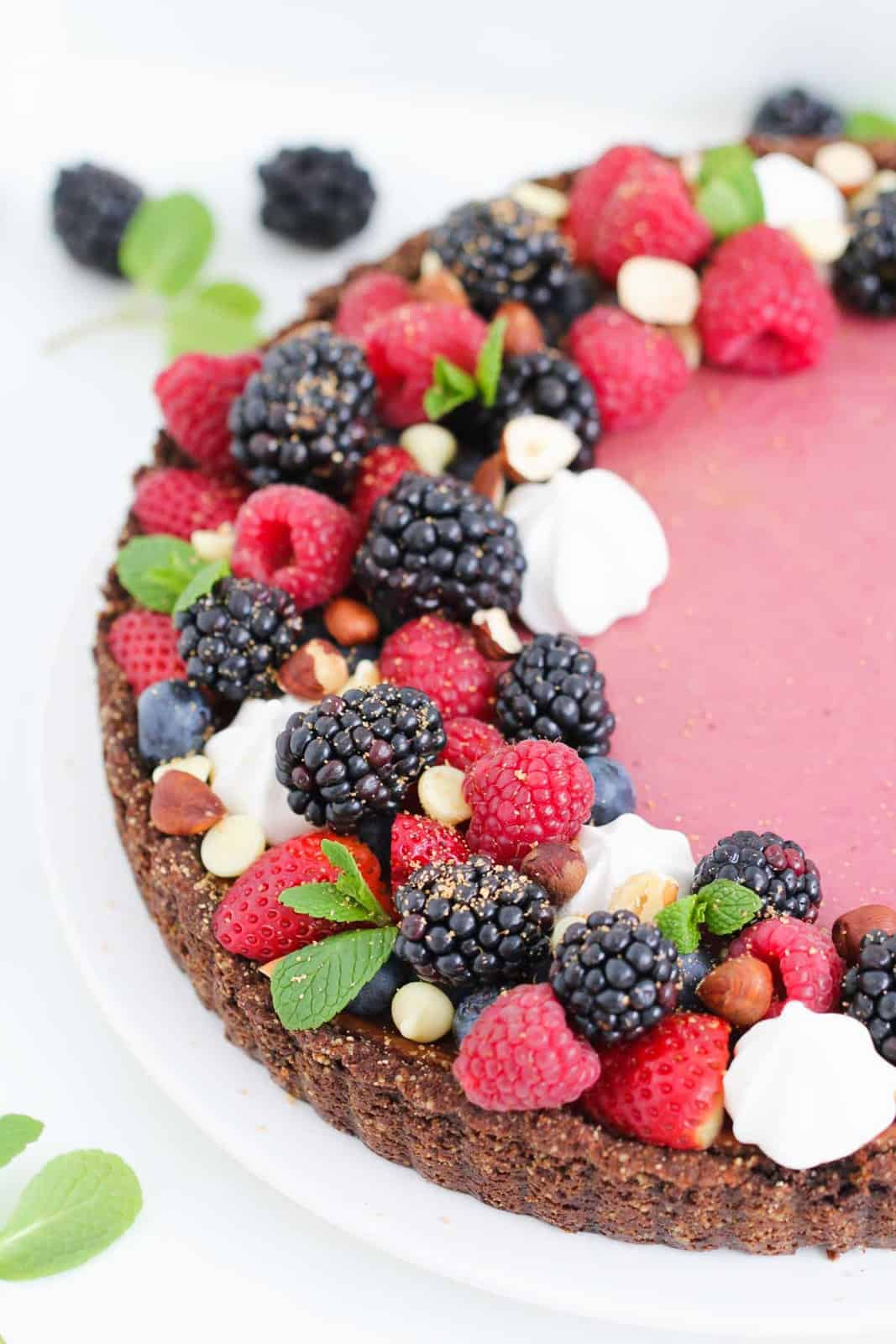 A Blackberry Cheesecake Tart decorated with blackberries and raspberries