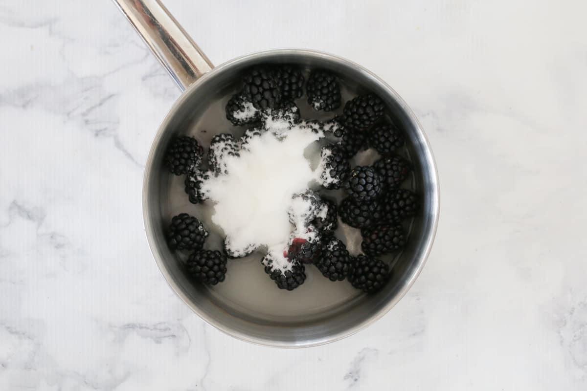 Blackberries, sugar and water in a saucepan.