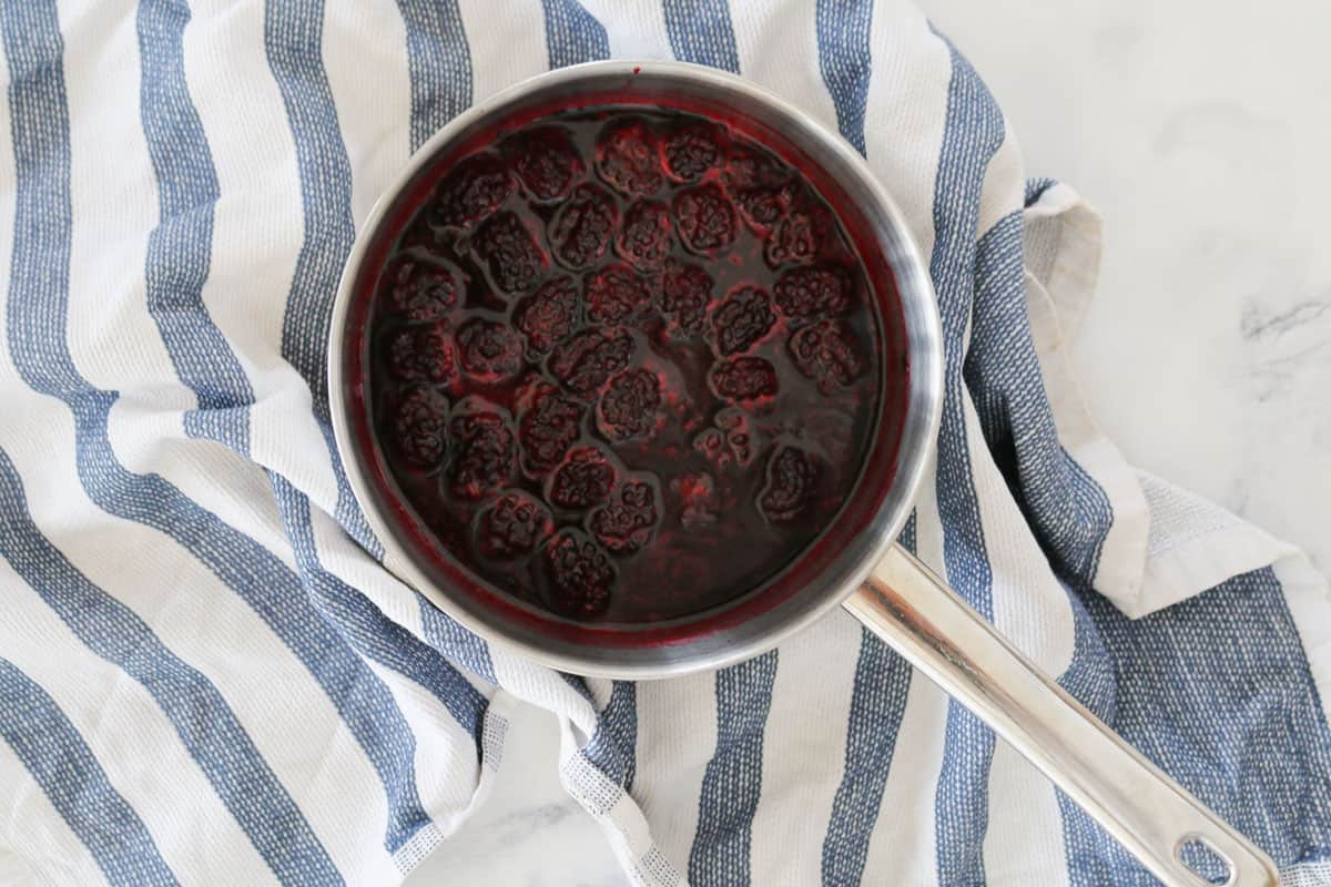 Blackberries in a saucepan that have been simmered until softened.
