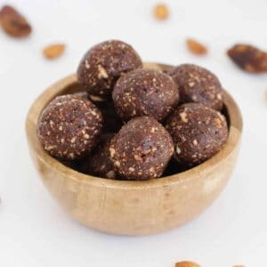 A bowl of chocolate almond balls.