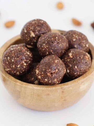 A bowl of chocolate almond balls.
