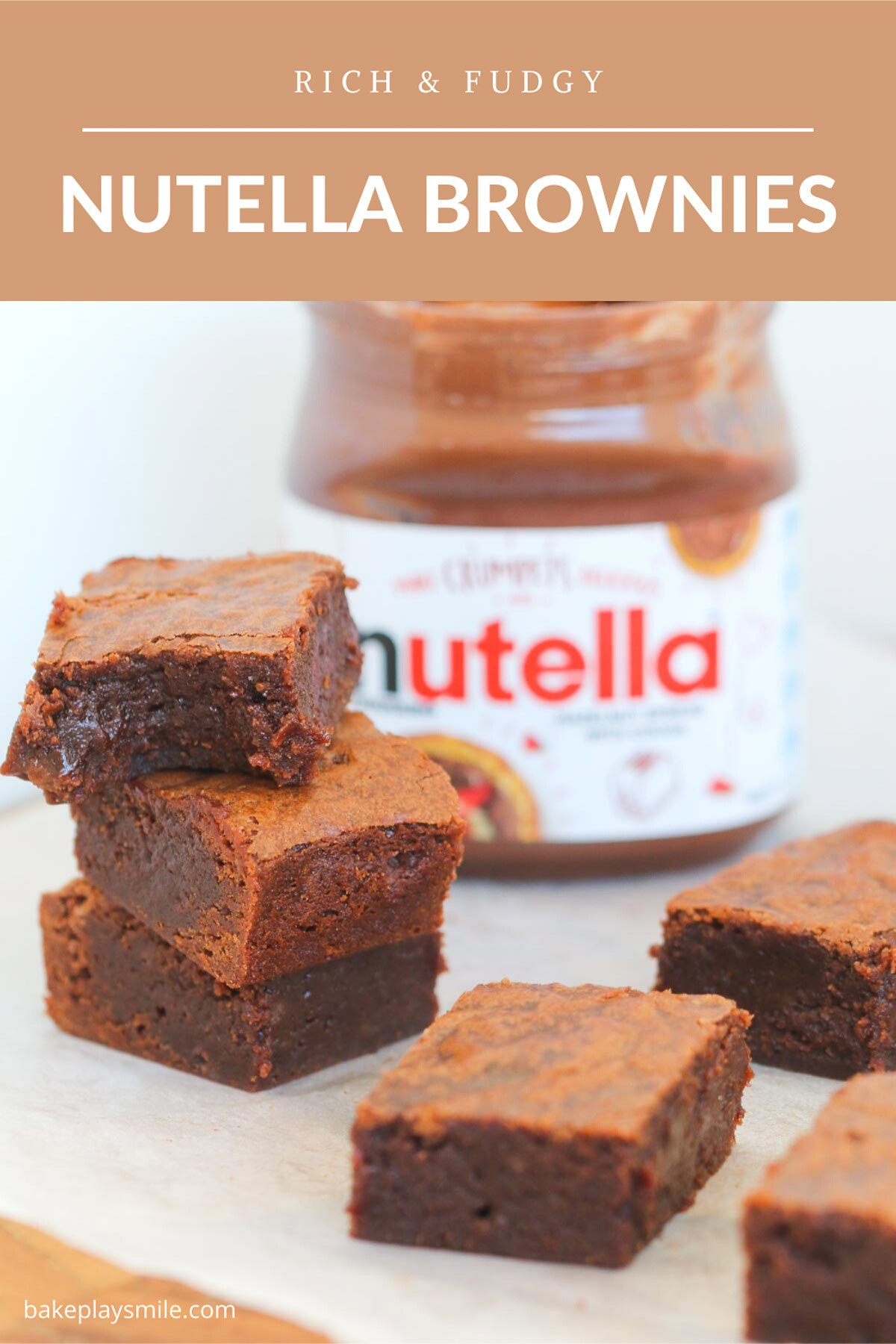 A stack of three chocolate brownies in front of a jar of Nutella chocolate hazelnut spread.