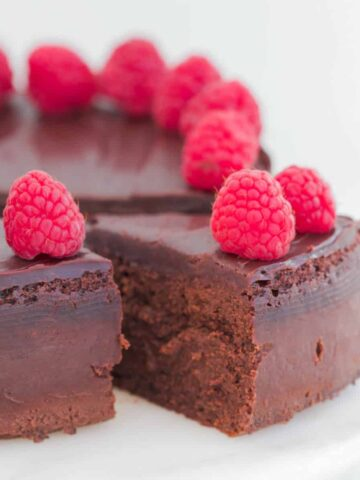 A rich mousse chocolate cake with raspberries and chocolate ganache.