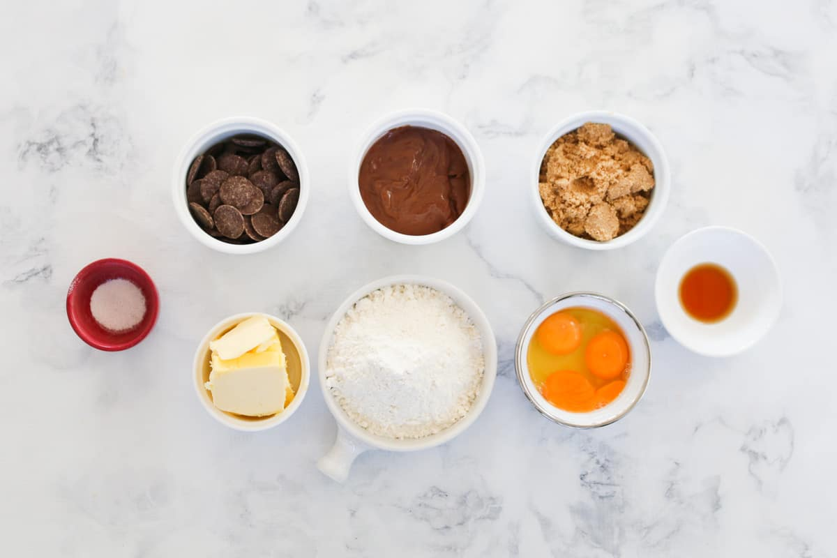 The ingredients for chocolate Nutella brownies in individual bowls.