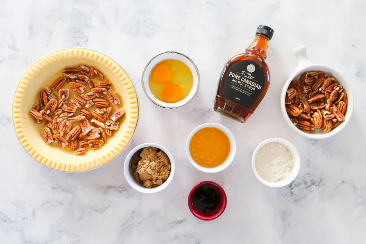 The ingredients for a homemade pecan pie.