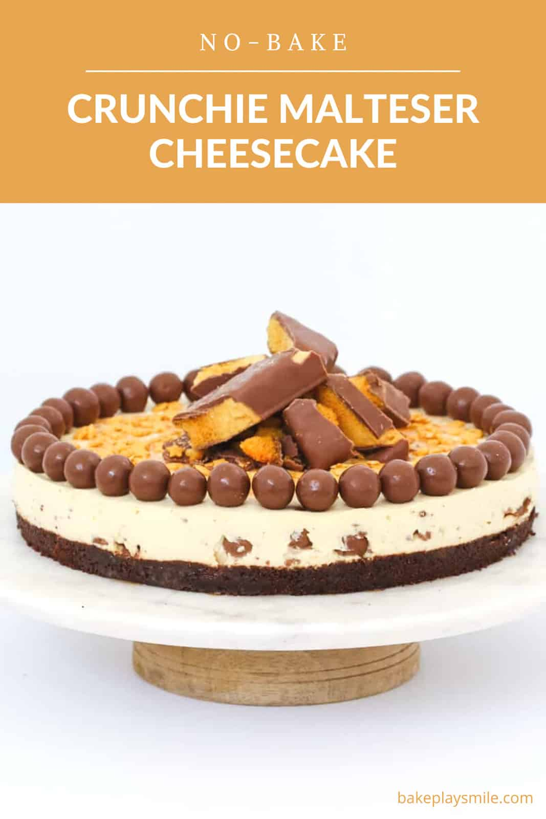 A round cheesecake with a chocolate biscuit base filled and decorated with chocolate honeycomb and malted milk balls.