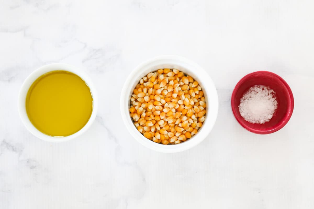 Bowls of oil, popcorn kernels and salt.