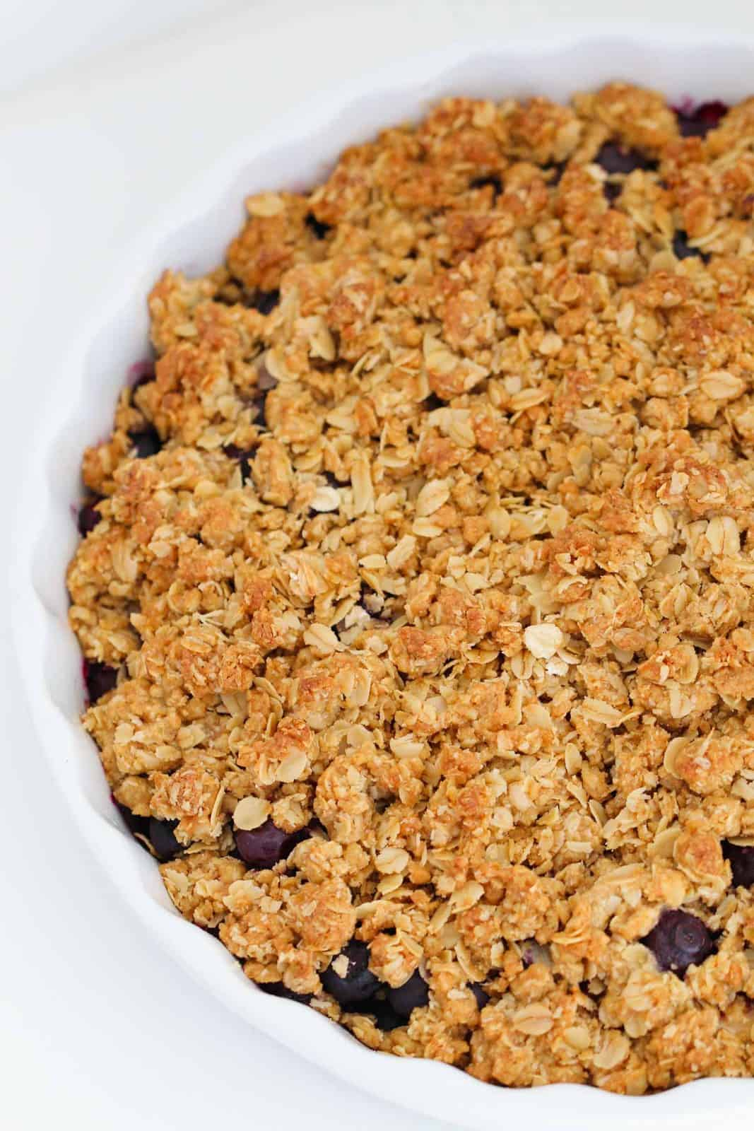 Overhead shot of apple and blueberry crumble in a baking dish