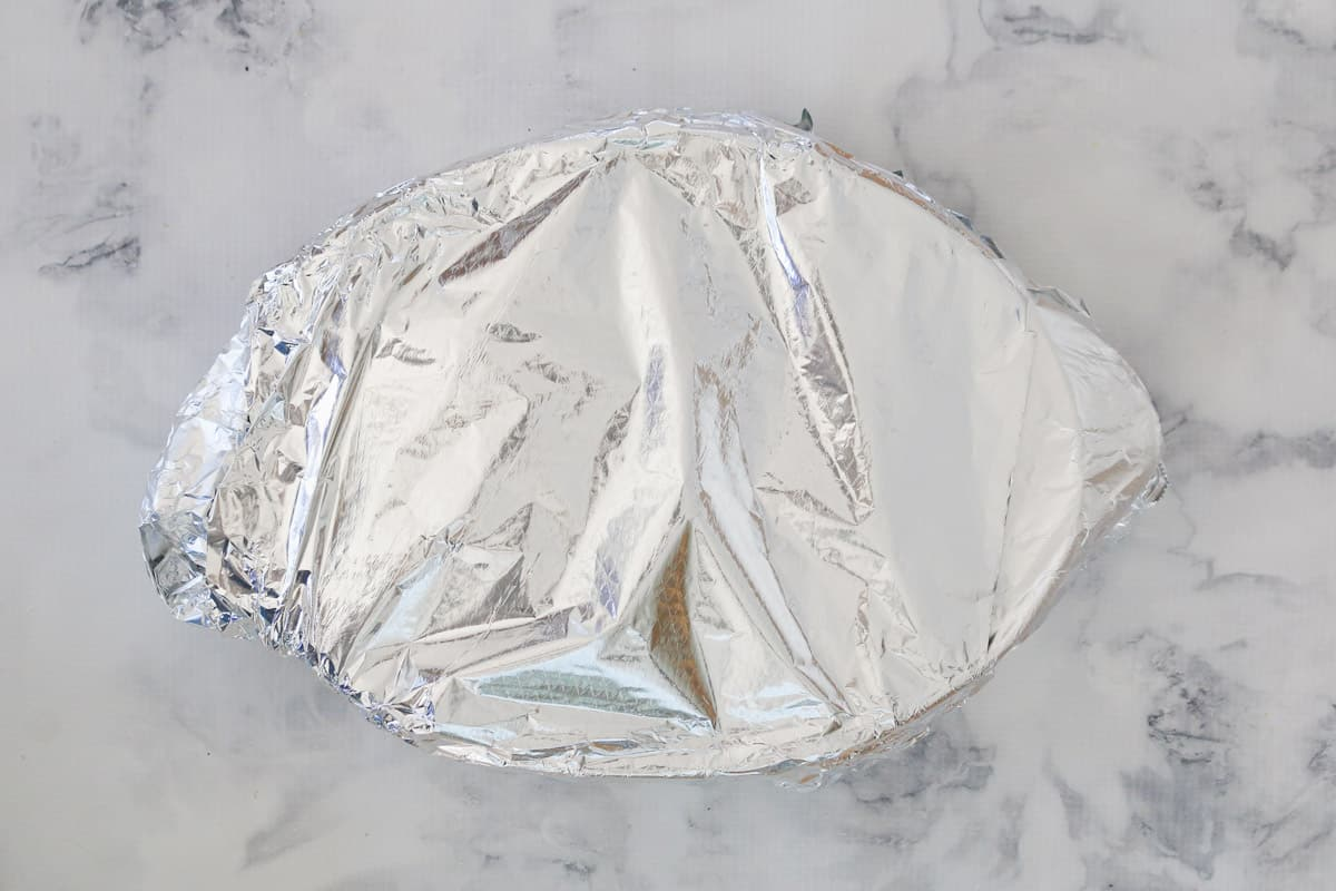 Foil covering an oval baking dish.