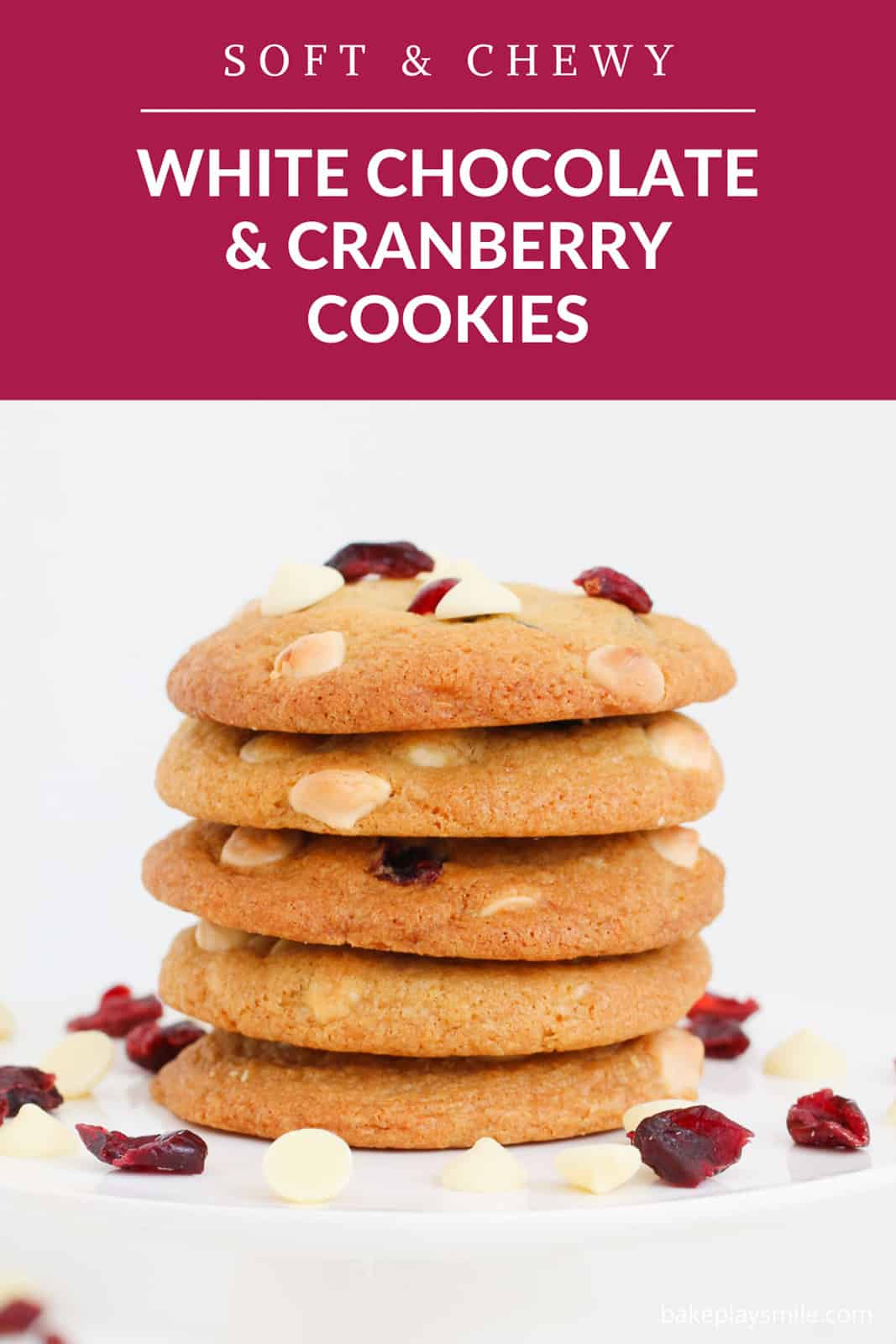 A Pinterest image with a stack of cookies with white chocolate chips and cranberries.