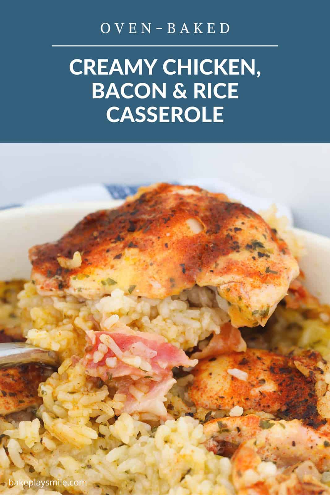 A casserole dish filled with spiced chicken, bacon and rice in a creamy sauce