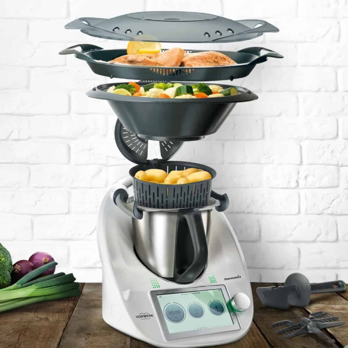 An image showing a Thermomix 6 model with the simmer basket and Varoma.