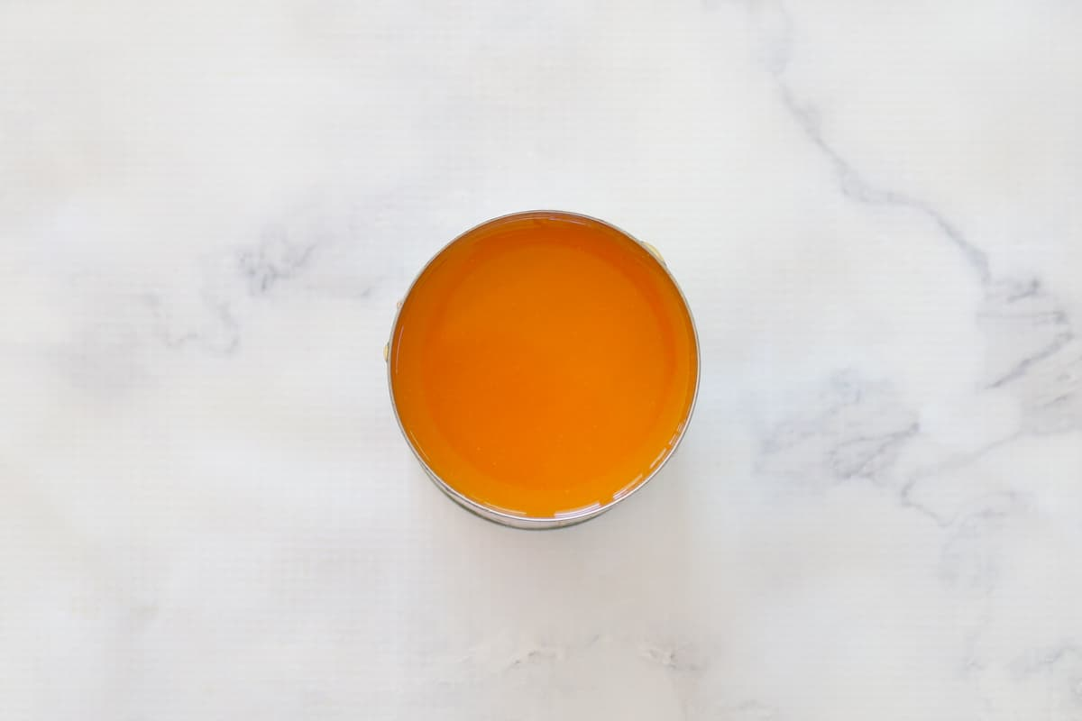 A tin of apricot nectar.