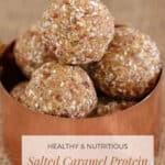 A copper bowl filled with caramel protein balls with sea salt.