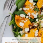 A Pinterest image with the text overlay 'Pumpkin, Spinach, Feta and Pine Nut Salad' and a bowl of salad in the background.
