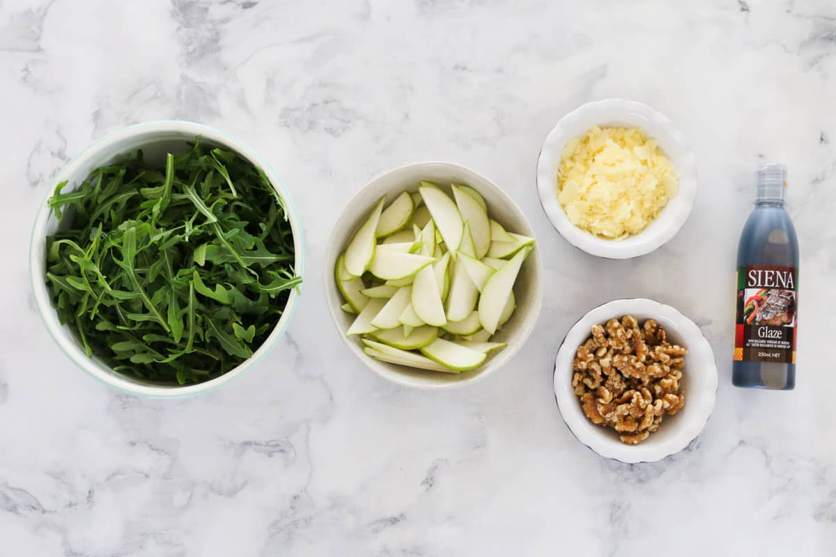 The ingredients for pear and rocket salad with parmesan, walnuts and parmesan glaze.