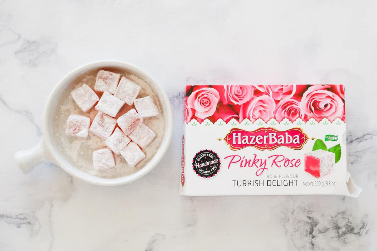A bowl with traditional Turkish delight and a box of rose coloured Turkish delight.