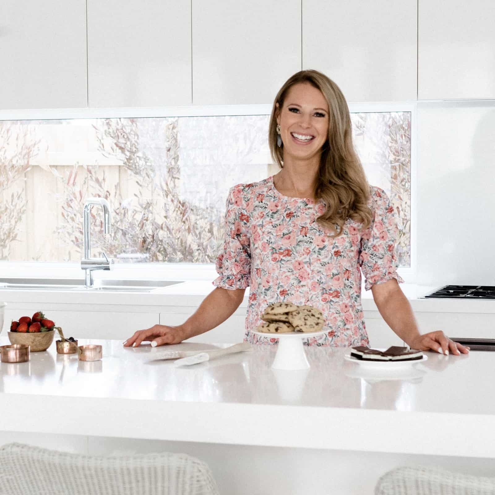 An image of Lucy from Bake Play Smile in the kitchen