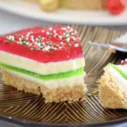 A half-eaten piece of layered jelly cake.