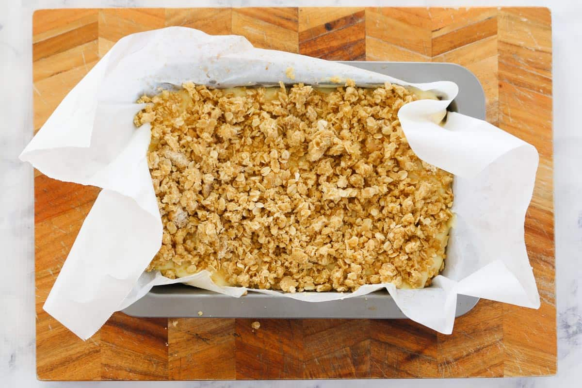 Rolled oats crumble on the top of a creamy lemon crumble slice