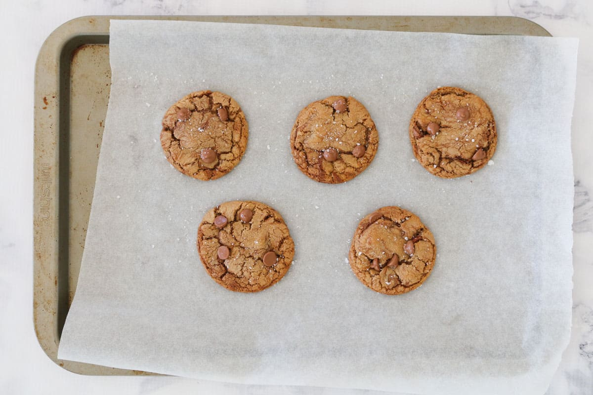 Nutella cookies on a parchment sheet covered tray.