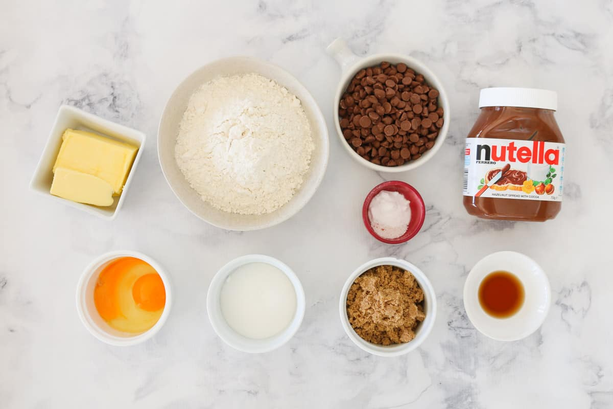 All the ingredients for cookies with Nutella and chocolate chips.