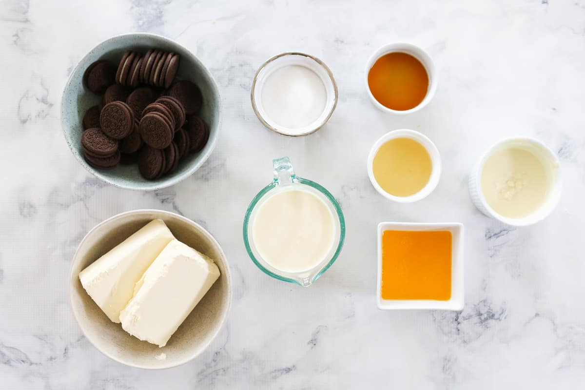 Ingredients for Oreo cheesecake slice in individual bowls