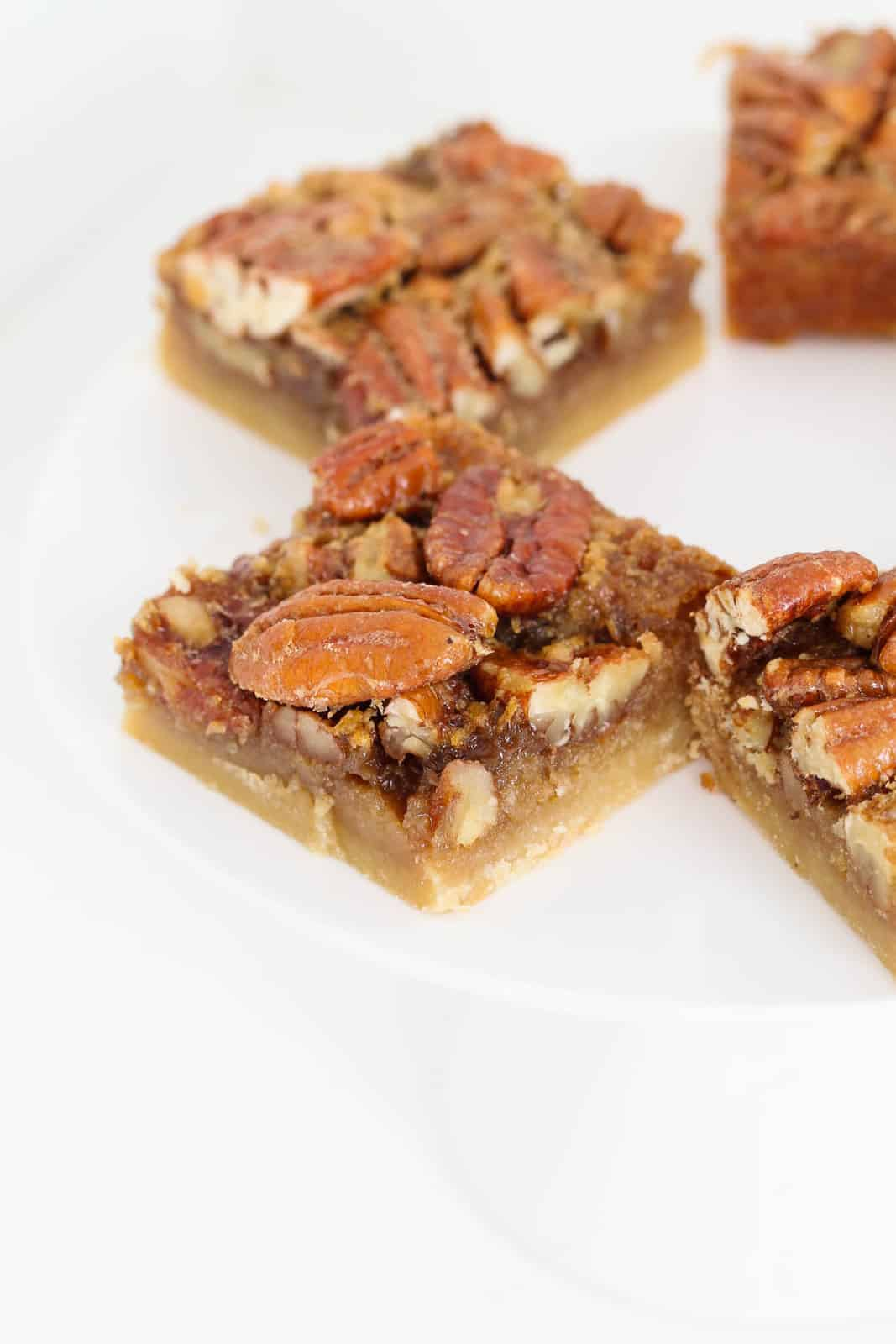 Slices of pecan pie bars on a counter