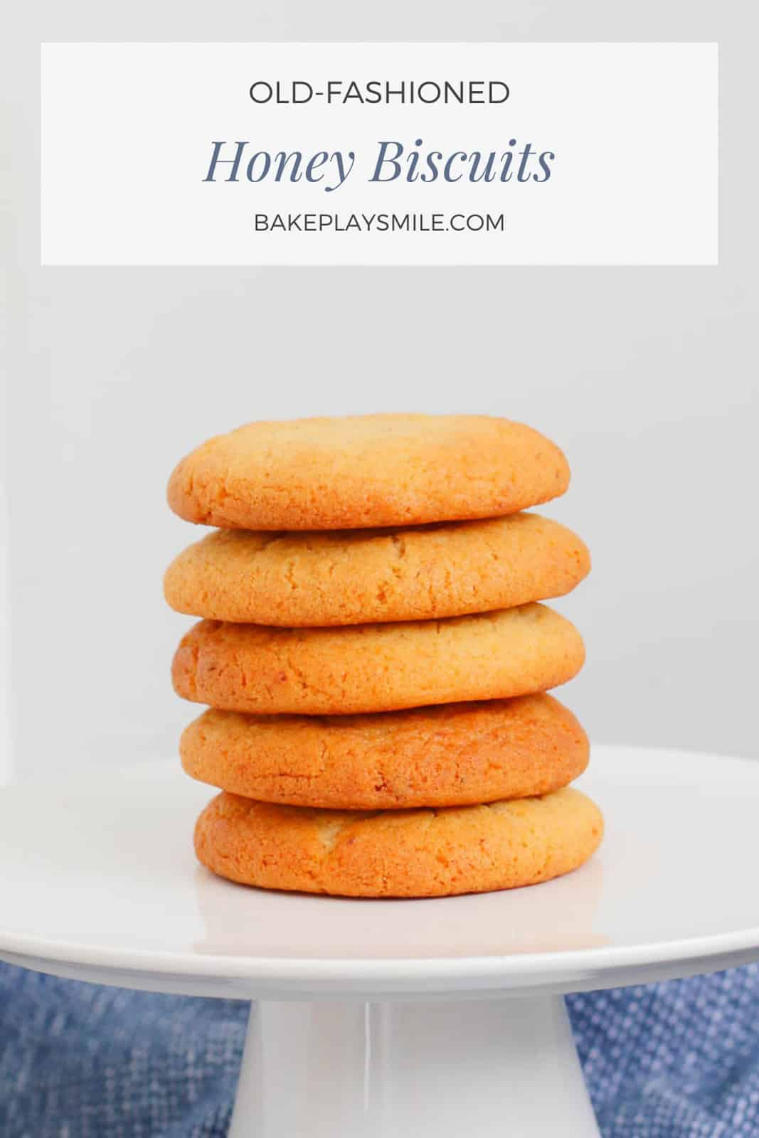 A stack of honey biscuits on a white plate.