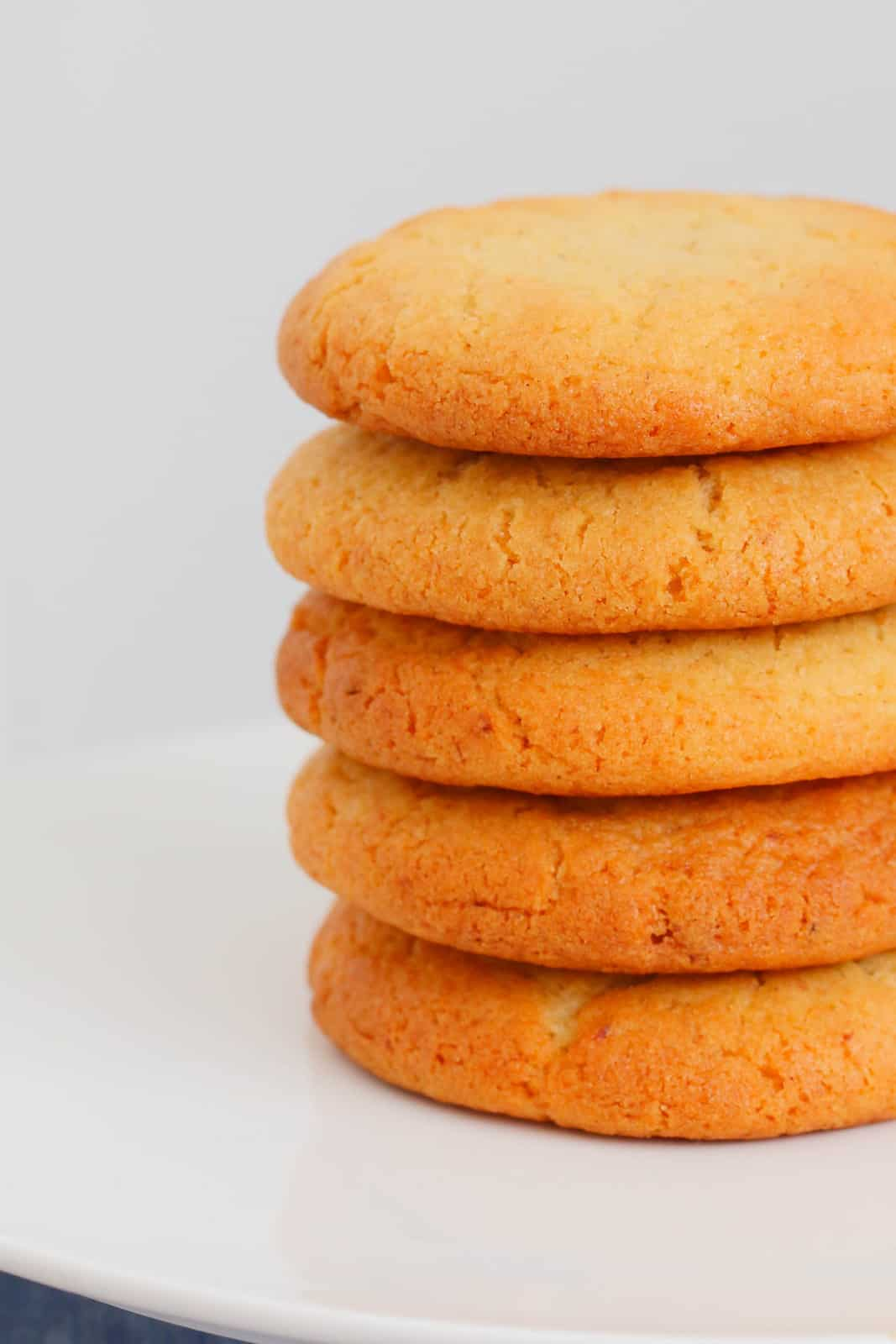 A close up photo of a stack of honey and cinnamon cookies.