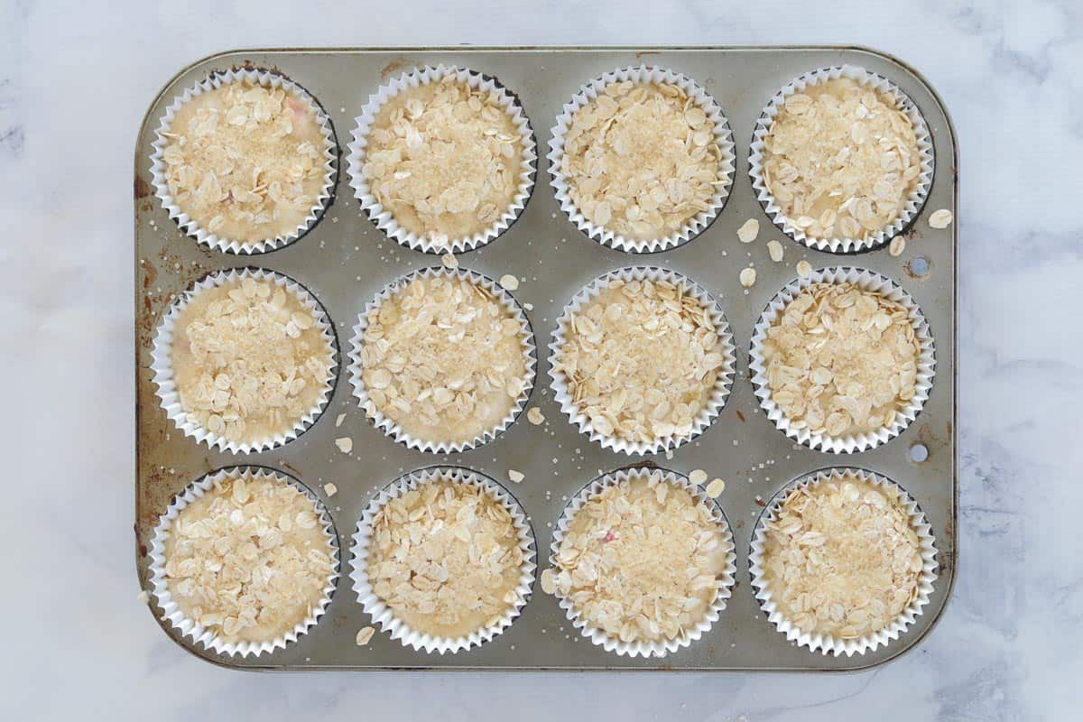 Unbaked muffins in a muffin baking tin