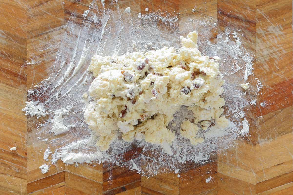 Fruit scones dough on floured wooden bench-top