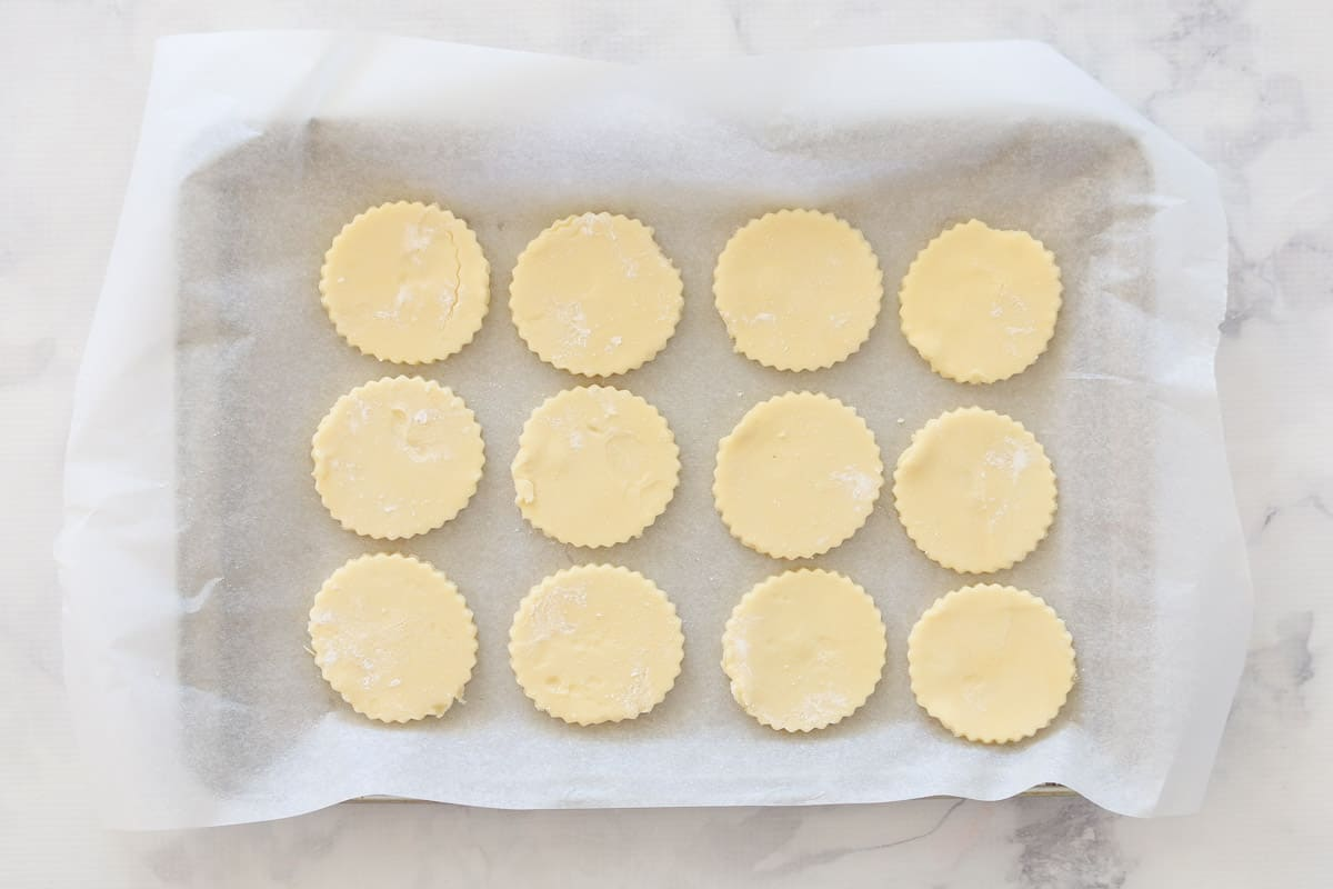 Cut out biscuits on lined baking tray